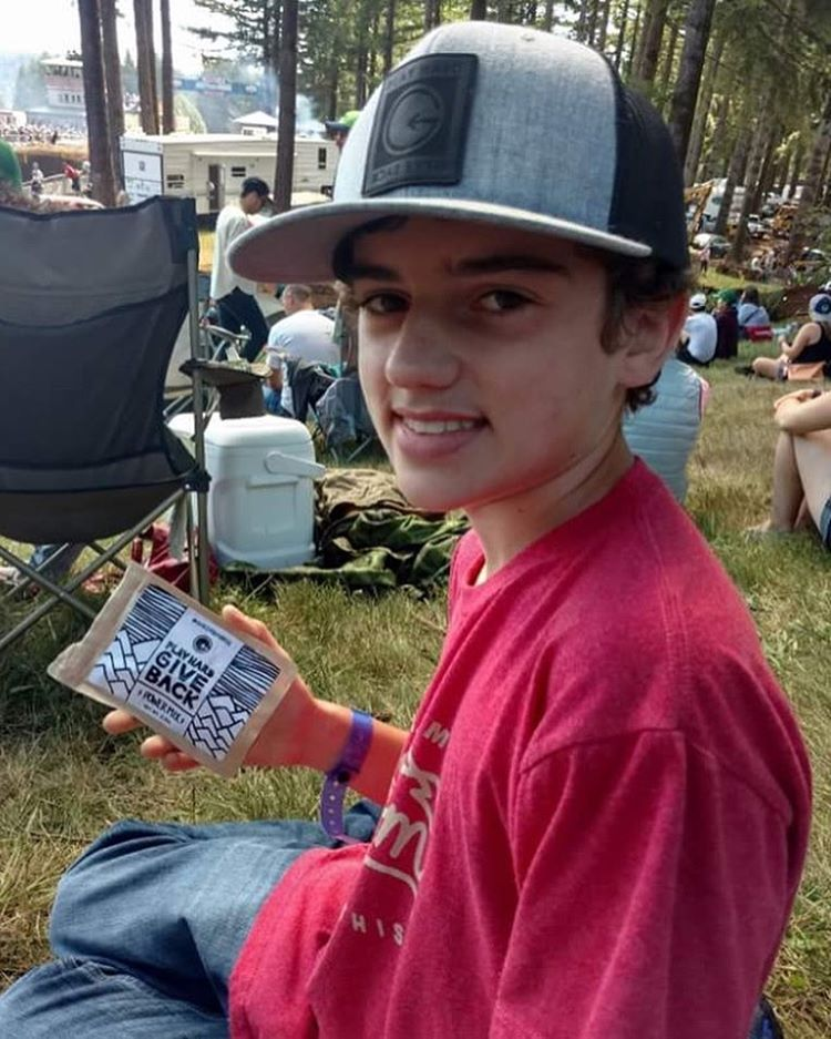 One of our biggest fans repping some PHGB apparel and snacking on the goods at Washougal Motorcross Park! #snackwithpurpose #playhardgiveback
