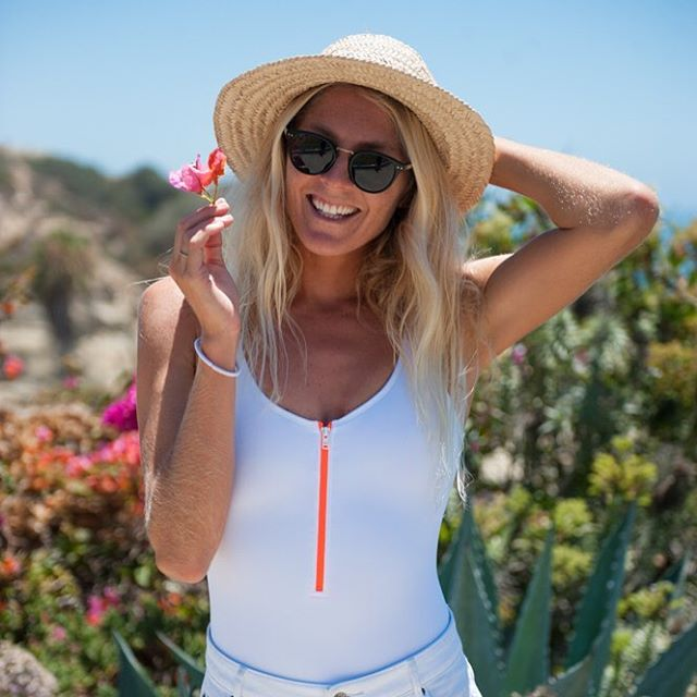 California L O V E! @stephaniegilmore soaking up the So Cal sunshine in the #ROXYxCourreges one piece