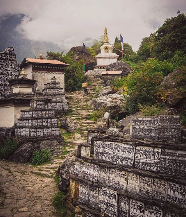 Mani walls in Solukhumbu (Everest Region). These stones are hand carved by devotees of Tibetan Buddhism as an offering to spirits believed to be protectors of the region.