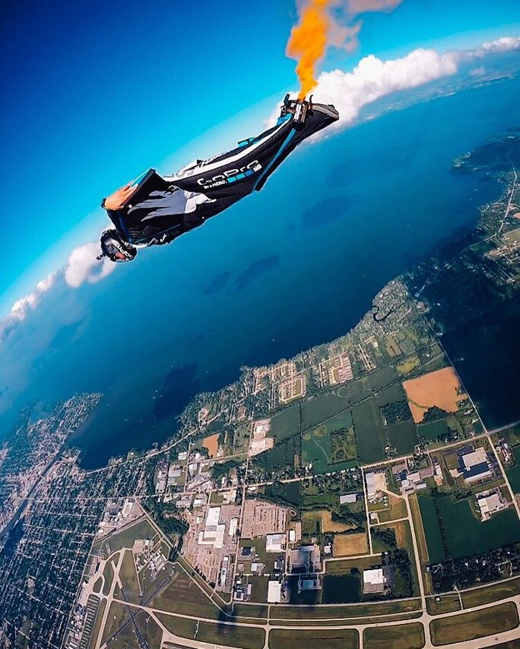 @marshall__miller + @goprobombsquad making an entrance to the #OSH16 airshow, the only way they know how! Welcome to the Worlds Greatest Aviation Celebration! #GoPro #GoProBombSquad #Flight #Skydive #Wingsuit