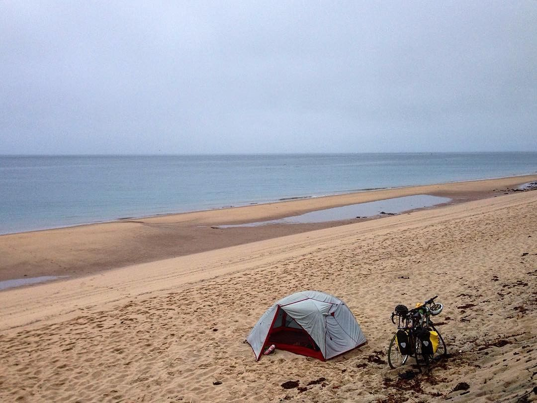 A great shot from @NomadicCycling taking advantage of the beautiful beach. #bikepacking #camping #beach #howwesleep #bike #bikecamping