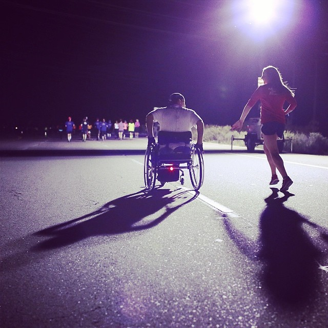 A runner joins a wheelchair participant in California for the #worldrun #wingsforlife