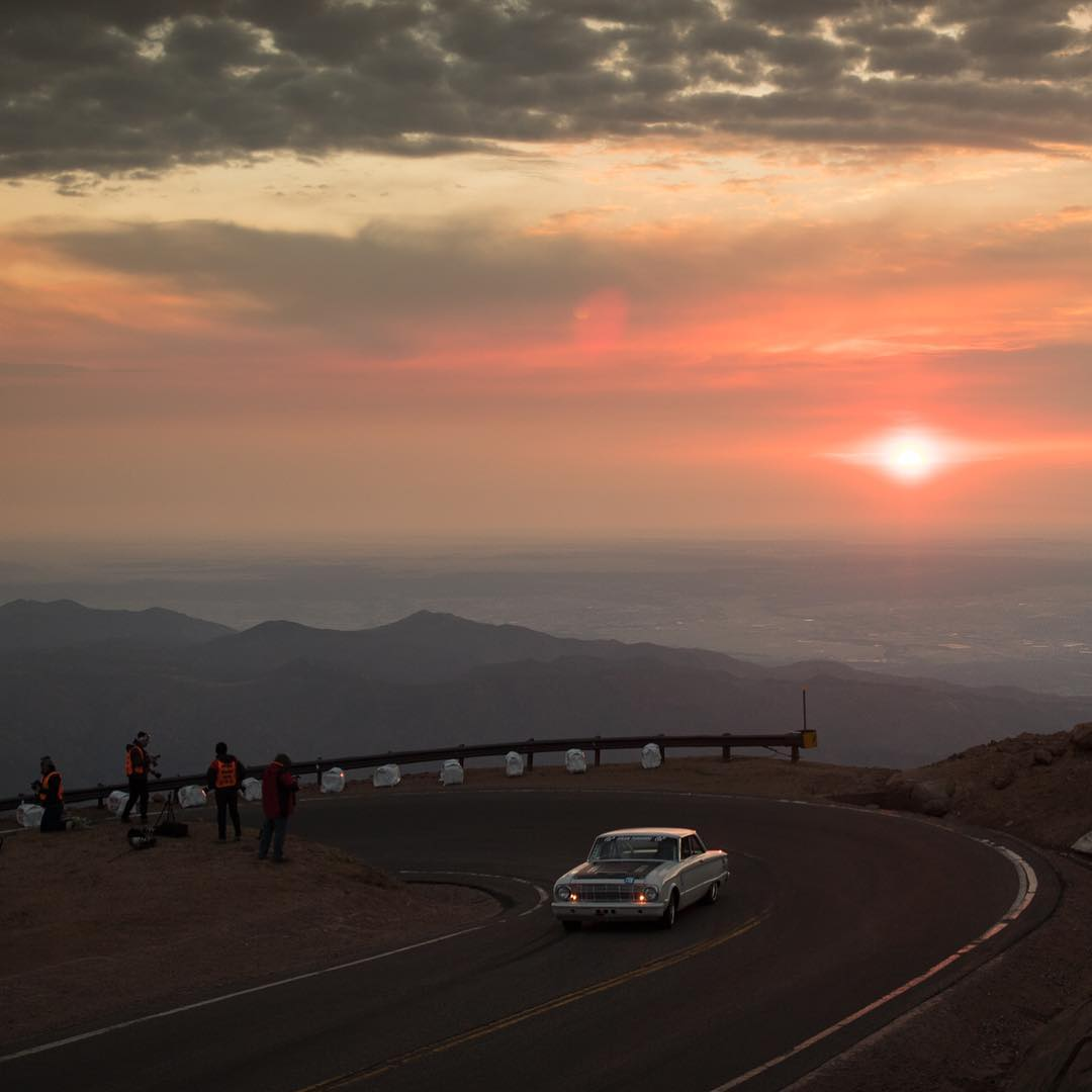 Don't let the epic view fool you, Pikes Peak is ALL business. Our buddy Aaron Kaufman (@thearclight) powering through in the @gasmonkeygarage built Ford Falcon. Photo by @larry_chen_foto  #pikespeak #ford #falcon #ppihc
