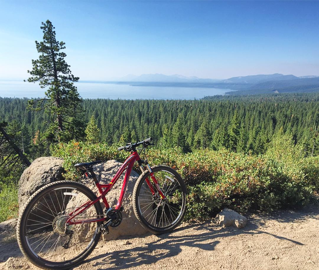 Pumped to be back in the saddle earning this view. Loved these flowy cross country trails - definitely some hero (confidence building) turns after not being on my bike for a while. #mountainbiking #viewsfordays #laketahoe #tahoe #roadtrippinwithrachel
