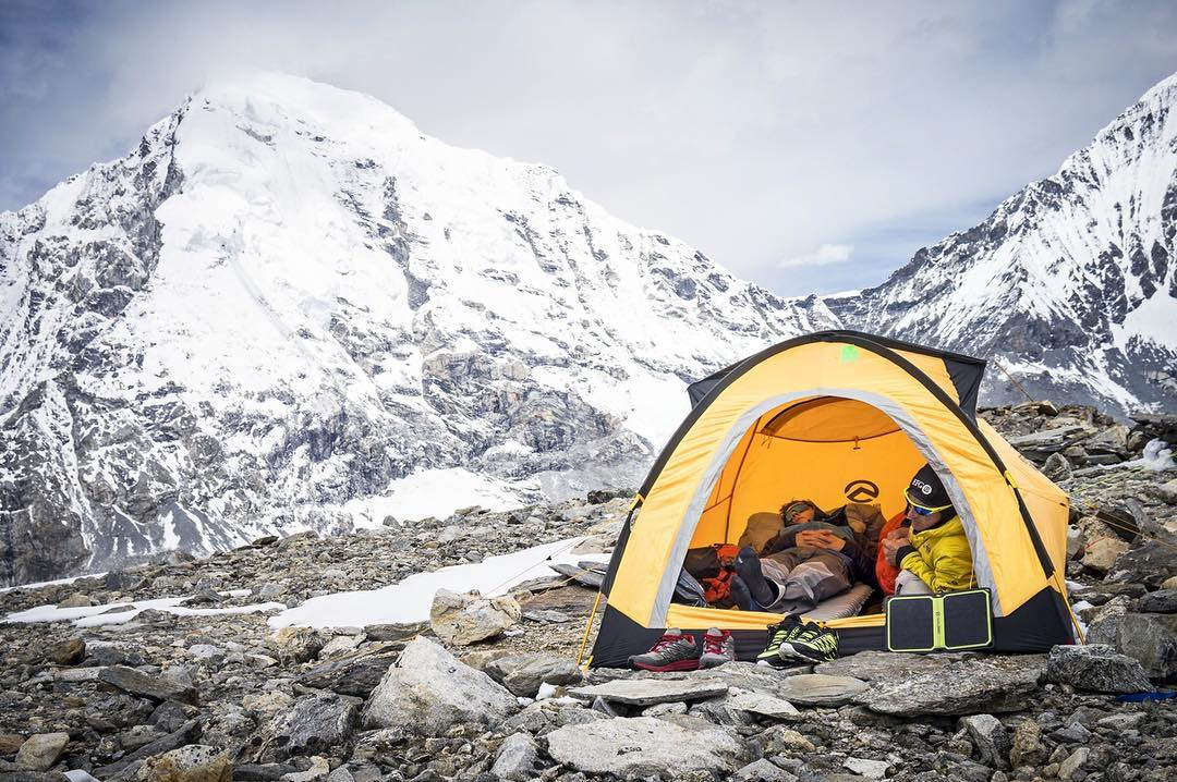Earlier this year @uelisteck and @david_goettler spent 5 weeks attempting different routes on Shishapangma's south face. Each time they were turned back by weather. Here they are talking a little break. #getoutstayout