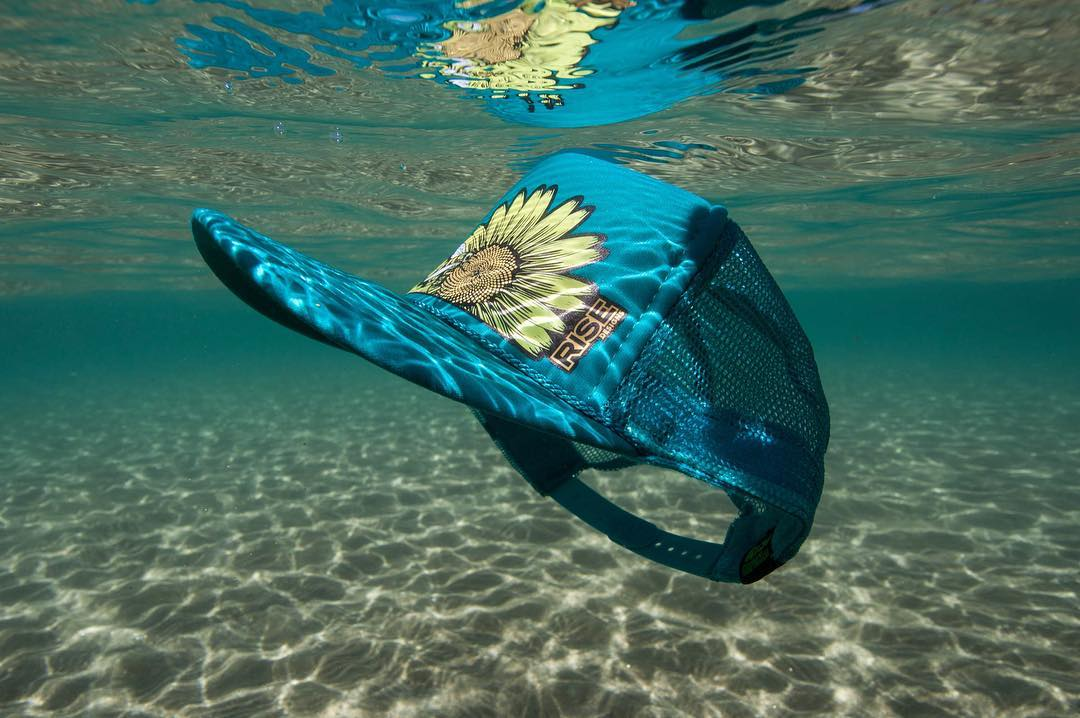 New product drops in the morning tomorrow. In the meantime, enjoy this shot of our Sunflower Bee Hat by @dylan_silver . #risedesigns #risedesignstahoe #laketahoe #underwater #flower #truckerhat #tahoelife #keeptahoeblue
