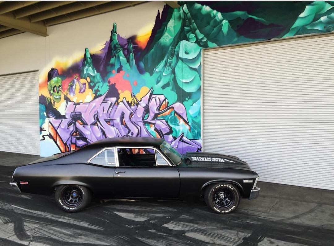 Always stoked to shoot stuff in front of the @ewokmskhm graf work out front of the #DonutGarage. #napalmnova #chevy #nova #hoonigan