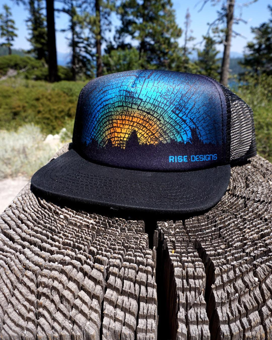 The Daybreak Trucker - now available in our shop or on our website. #truckerhat #drivenbydesign #inspiredbynature #risedesigns #risedesignstahoe #woodgrain #flatbrim #trees #getoutside