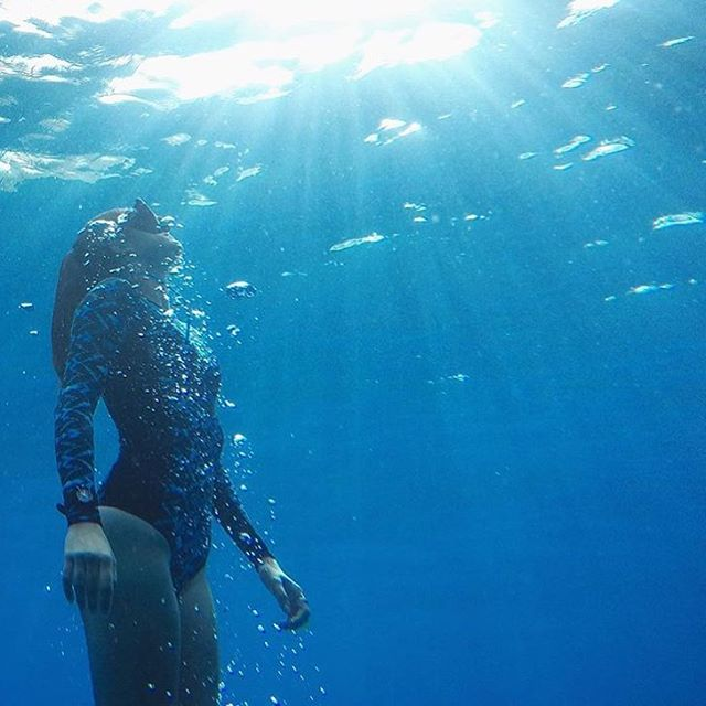 Breathe it all in. Ambassador and true mermaid @howiwishiwasafish exploring the deep blue. Keeping it this color blue is why we're a @1percentftp member. 1% of sales to the environmental group of our choosing. You better believe we choose to protect...