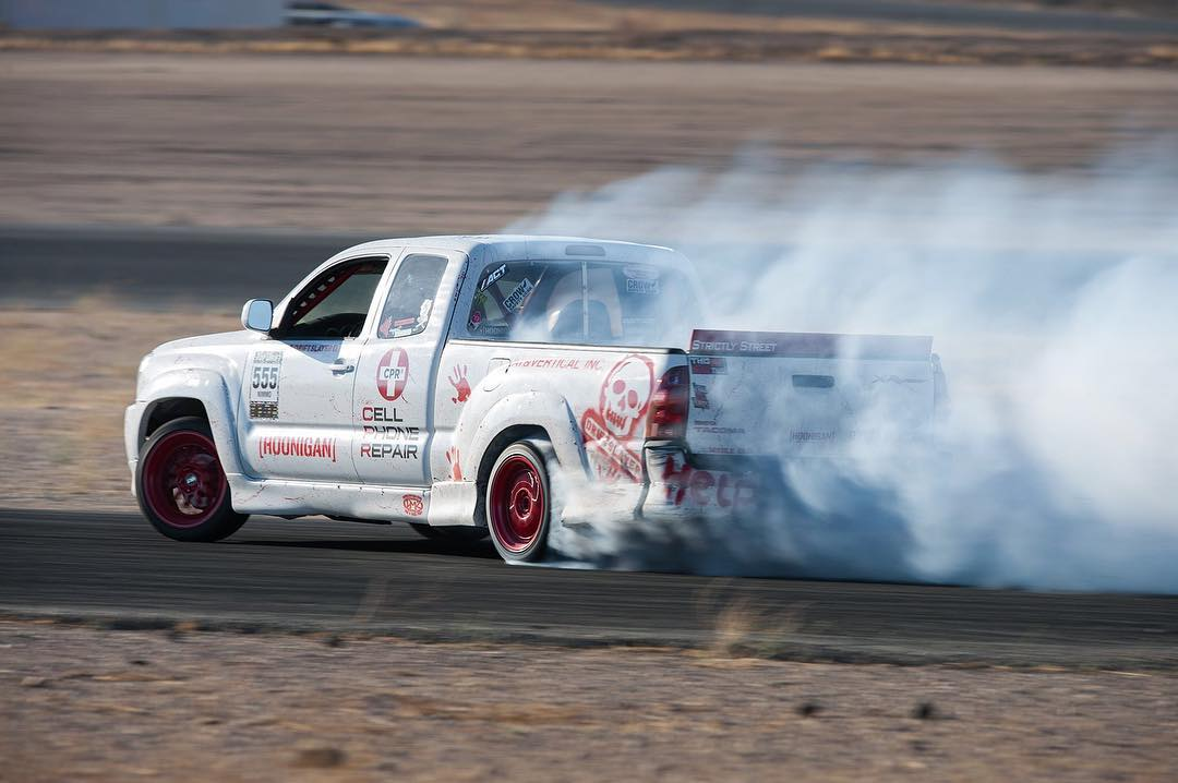 Our dude @driftslayer has more skill than hp. His Tacoma is made up of mostly stock running gear (engine-wise). We'd love to see what he can do with a couple hundred more ponies under the hood! #hoonigan #drift #tacoma