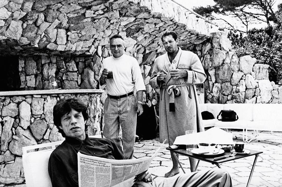 "#FlashbackFriday feels with the boys | Mick Jagger, Dennis Hopper and Julian Schnabel in Cap d'Antibes, France, 1991 | Photo by Jean ""Johnny"" Pigozzi."