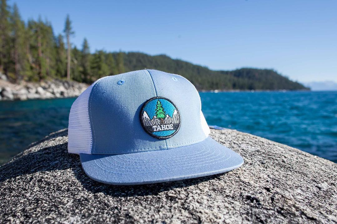 The Tahoe Circle Patch is looking good on this baby blue hat. Especially on Lake Tahoe. Need a new hat? We got you covered. #risedesigns #risedesignstahoe #tahoeart #hat #laketahoe #lakelife ⚡️