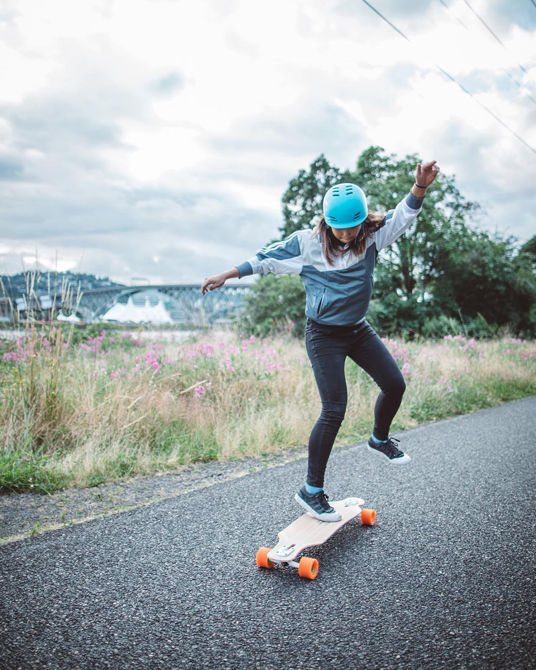 Caught in the act, @iamcindyzhou breaks out a pirouette while cruising down the skate path in Portland.