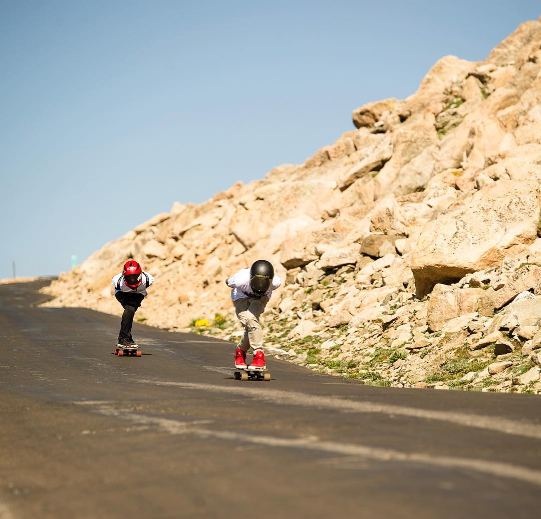 @awsomaustin and Gaven up at the top of Mt. Evans.  Where's the most unique place you've longboarded?  @traverse_image #longboarding #mtevans #landspeed #gofast #downhilling #longboard #concretecoast