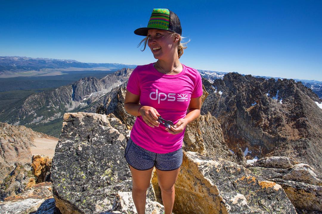 A bonanza of new men's and women's t-shirts enters the mix. Follow the link in our bio to shop the full line of DPS apparel and accessories. PH: @skridde atop Thompson Peak, Idaho sporting the new Women's Standard T-Shirt, with @libbe_ellis