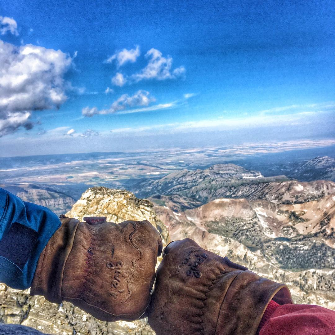 Casual fist bump atop The Grand Teton with Give'r athletes @barnyarrd and @hunteybadger validating their 4-Season Gloves from 13,770 ft.  #bestdamnglovesever #gtnp