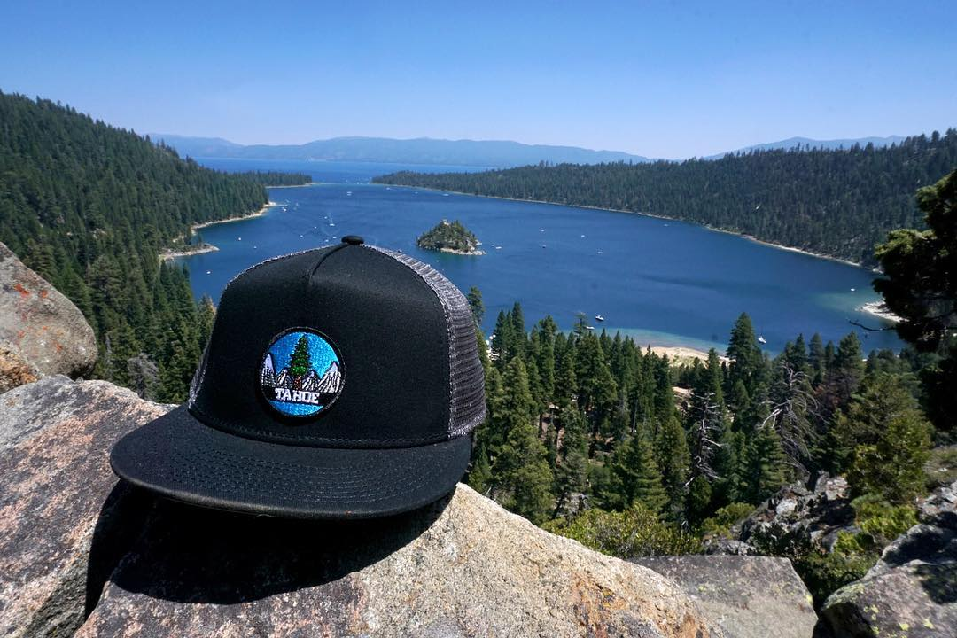 Lake vibes at Emerald Bay with the Tahoe Patch Hat. Grab yourself a fresh at www.risegraphics.com #risedesigns #risedesignstahoe #snapback #tahoelife #emeraldbay #hat #california #blueskies