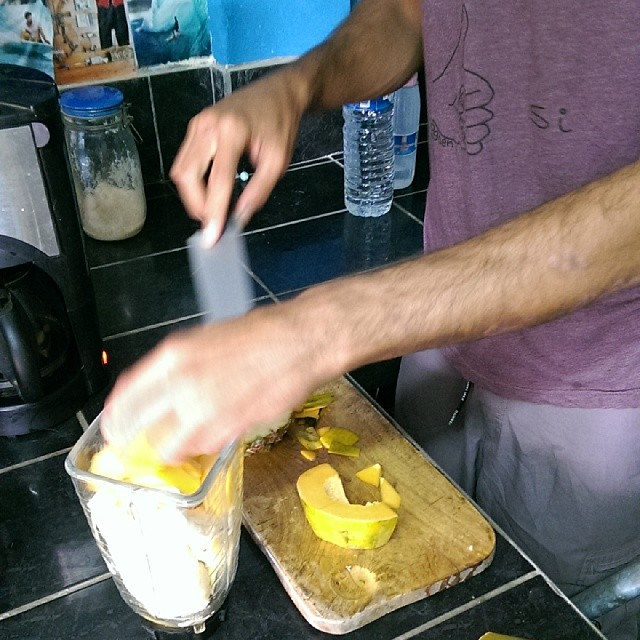 Nico making smoothies for all the volunteers in his slick @ogdenclothing tee. Fresh pineapple, papaya and banana, yum!