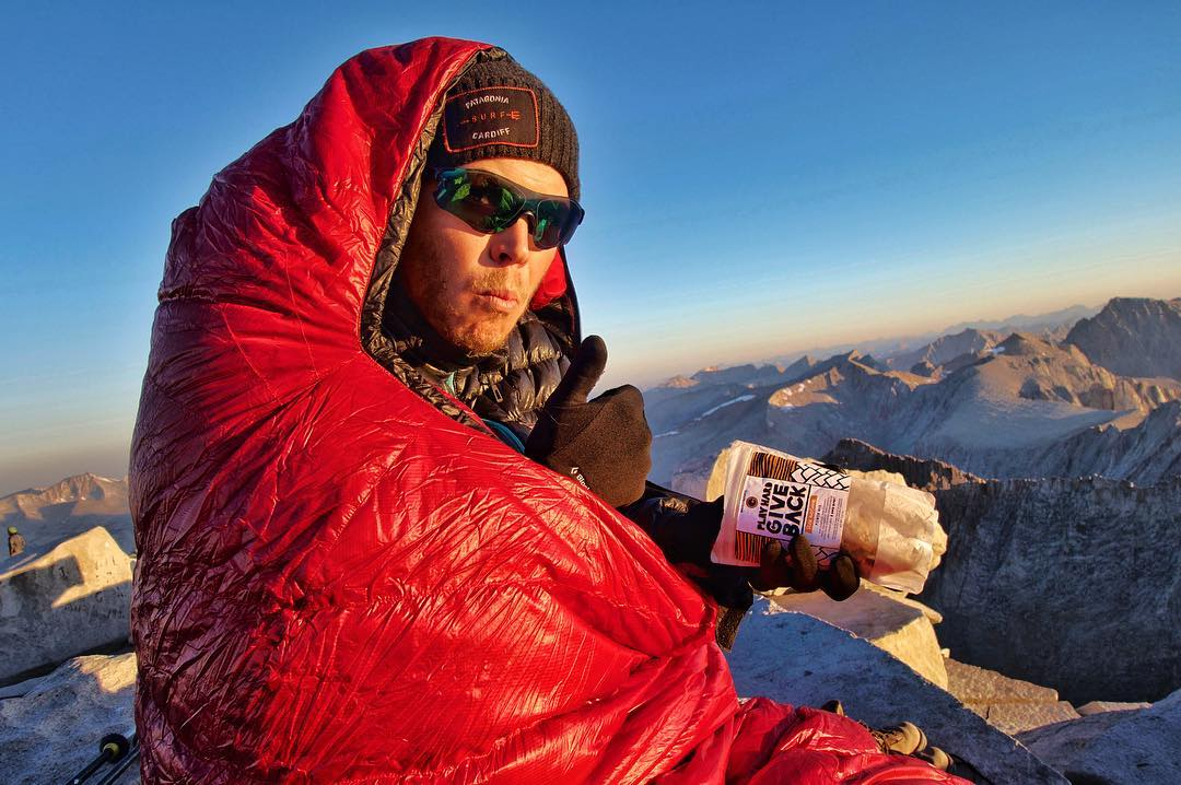 "Nom nom nom!! @sam.brink enjoying some ""Rise and Shine"" #phgb #trailmix on top of #mountwhitney at the end of the #jmt!"