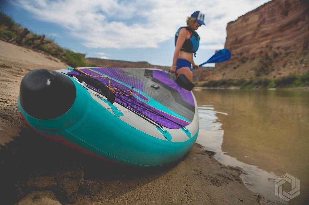 yoga_snow_love pulling her Hala Atcha into the Colorado river to enjoy some sup yoga.