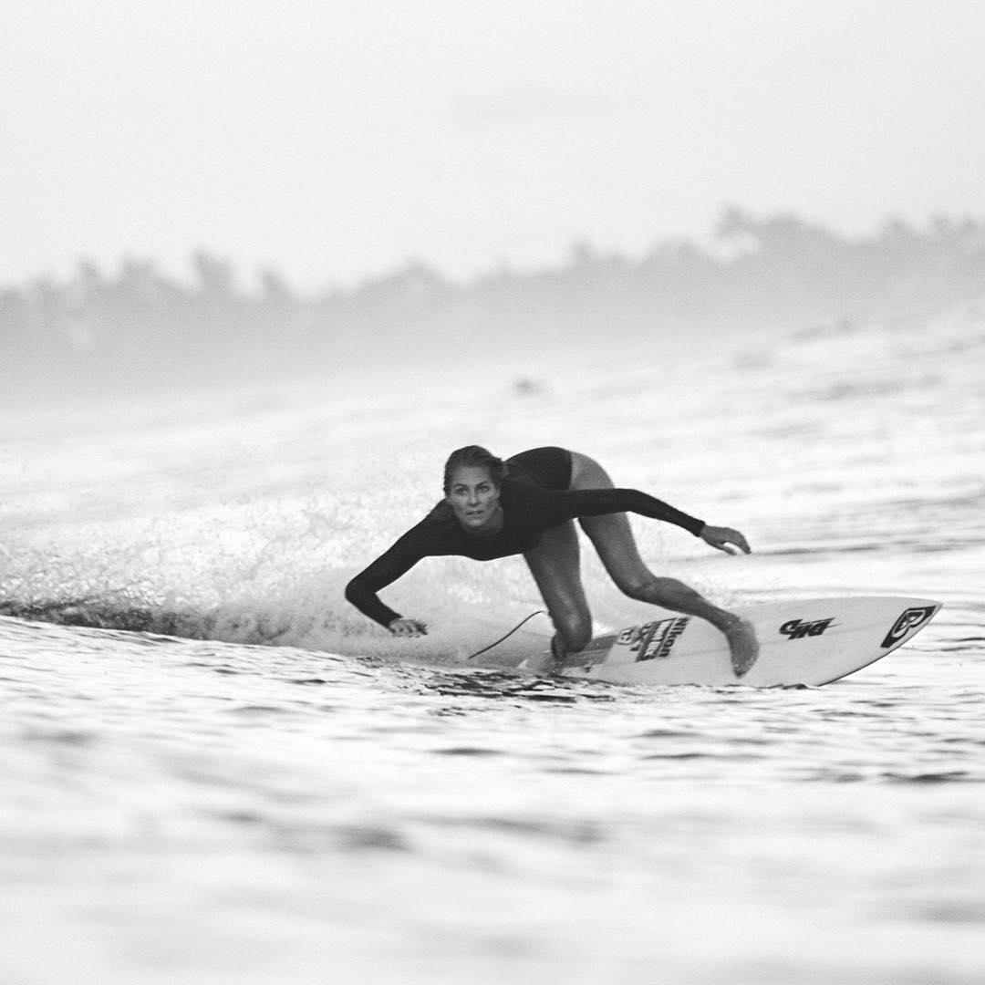 @stephaniegilmore ripping it in the #POPsurf Onesie swimsuit