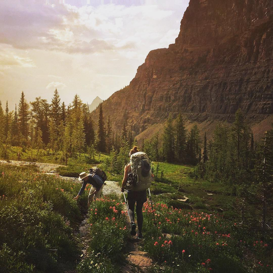 Thank you, @nationalparkservice for 100 years of beautiful moments like this one in Glacier National Park. Captured by @juliehotz while hiking the PNW Trail & collecting water samples to test for freshwater microplastic pollution. . Here's to 100 more...
