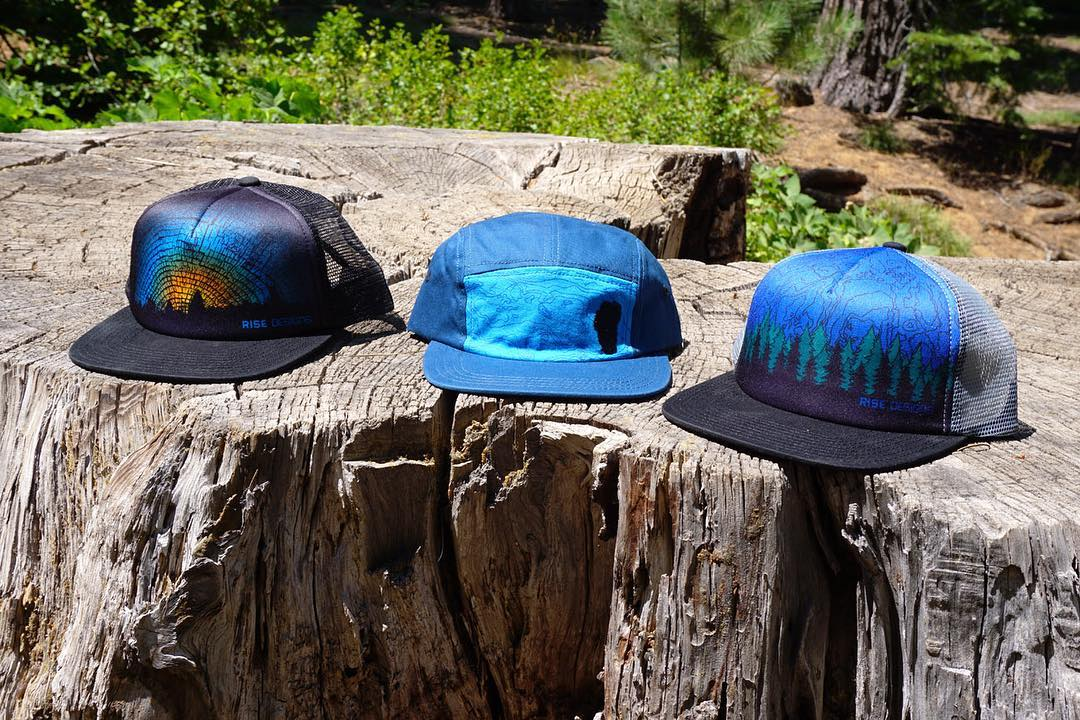 All of our new cut and sew hats. All inspired by nature and driven by design. Trucker hat or Camper style we have something for everyone. Grab one today! #risedesigns #risedesignstahoe #hats #daybreak #tahoebasin5panel #forestexplorer
