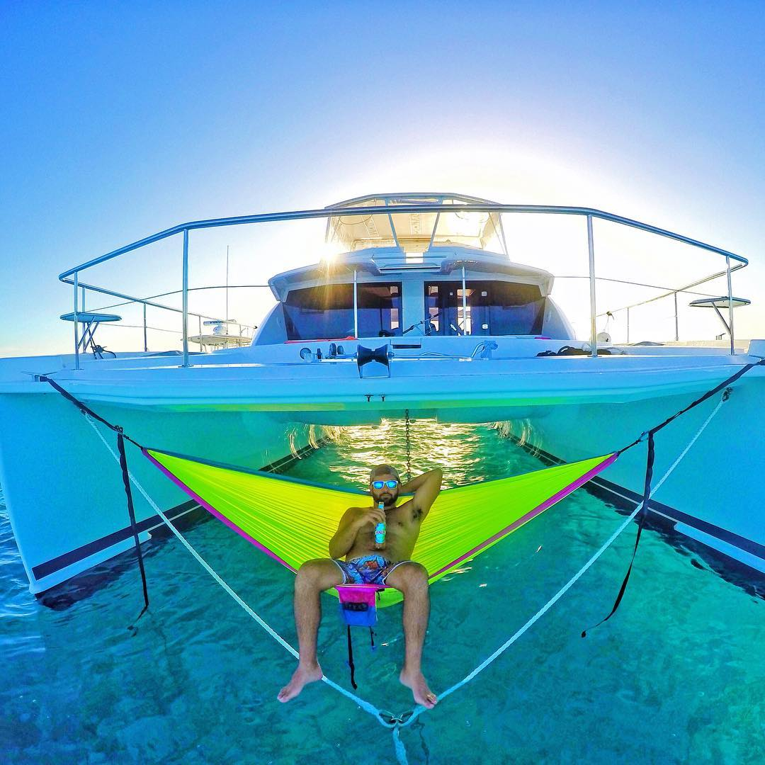 Cheers to a relaxing weekend! Photo by @miaoulis17. Shot with GoPro HERO4 Silver & GoPole Evo. #gopro #gopole #gopoleevo #labordayweekend #hammock
