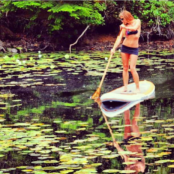 @swellliving doing some #sunday #suping with her #favorite #paddle @paddlehawaii in the #enchanted #pond #sundayfunday #sup #explore #bikiniadventure