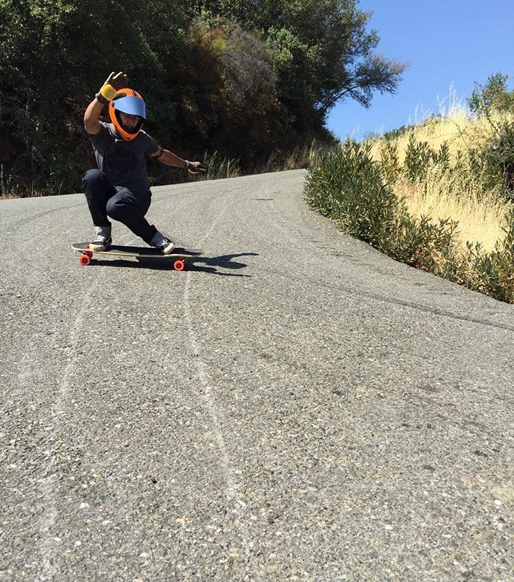 #LoadedAmbassador @ethancochard confusingly slides switch fakie into a dropping left, somewhere deep in the dry hills of a town full of cows.  Photo: @camilocespedes  #LoadedBoards #Tesseract #Cantellated #Orangatang #orange #TheKilmer