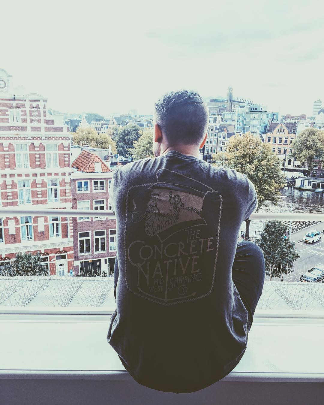 Taking in a great view of the canals in Amsterdam in the Ahab Tee.