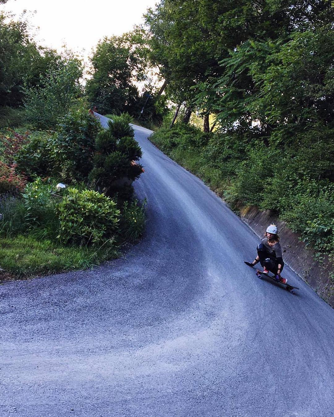 @rosanne_onboard hitting the steeps on her Keystone. #downhill #skateboarding #longboardlife
