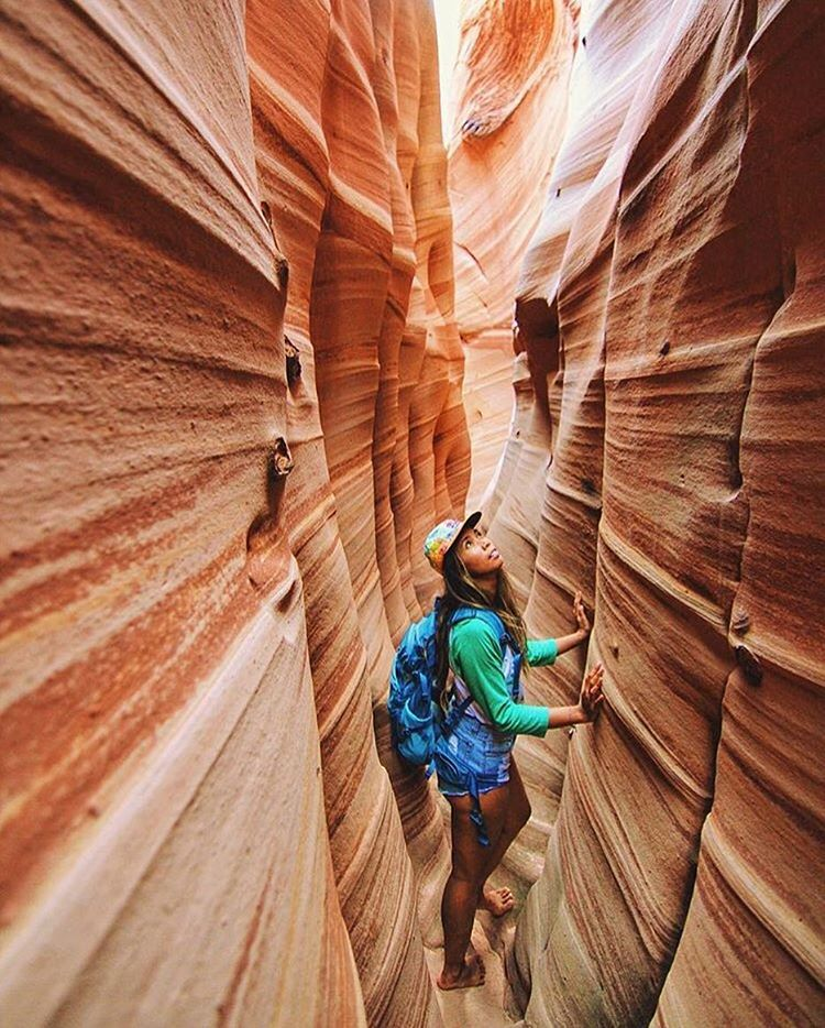 ZEBRA SLOTS Digging this shot of @meloweeniee exploring the sandstone walls in one of our raglan tees.