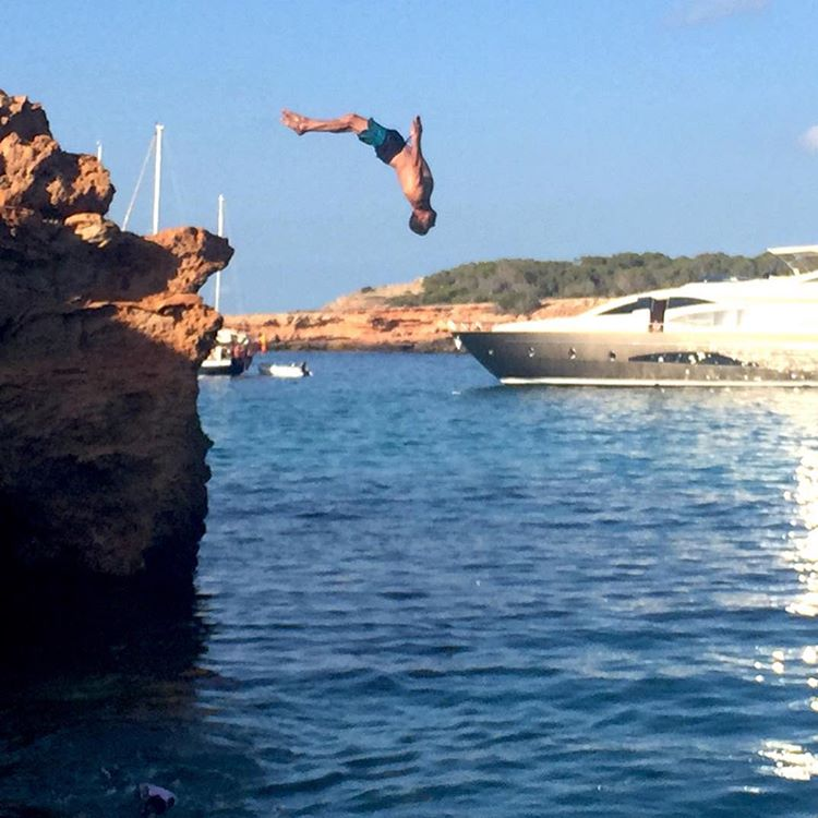 Just another backflip photo… except for that large/bougie yacht photobomb here in Ibiza. Yeah, I like it here! #icouldgetusetothis #Ibiza #blockflip