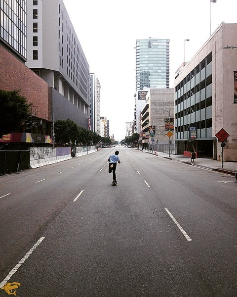 #LoadedAmbassador @adler_skate takes advantage of an empty street in DTLA to put on a private show for the lonely buildings.  Photo: @ari_shark  #LoadedBoards #Tesseract #Ciclavia #Orangatang