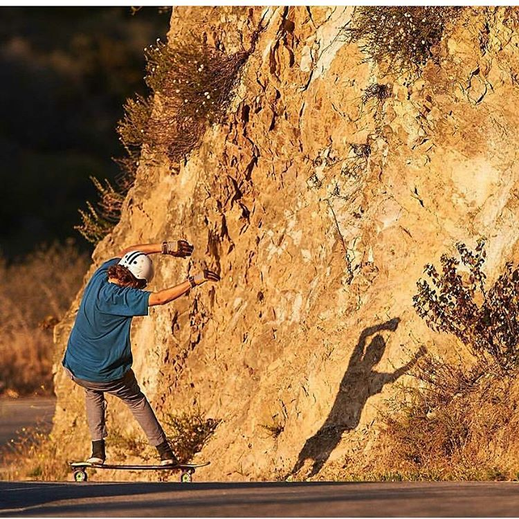 #LoadedAmbassador @kalilhammouri throwing shade on the rock walls of Malibu.  Photo: @jaimi_joy  #LoadedBoards #Tesseract #Cantellated #Orangatang #Kegels #Purple