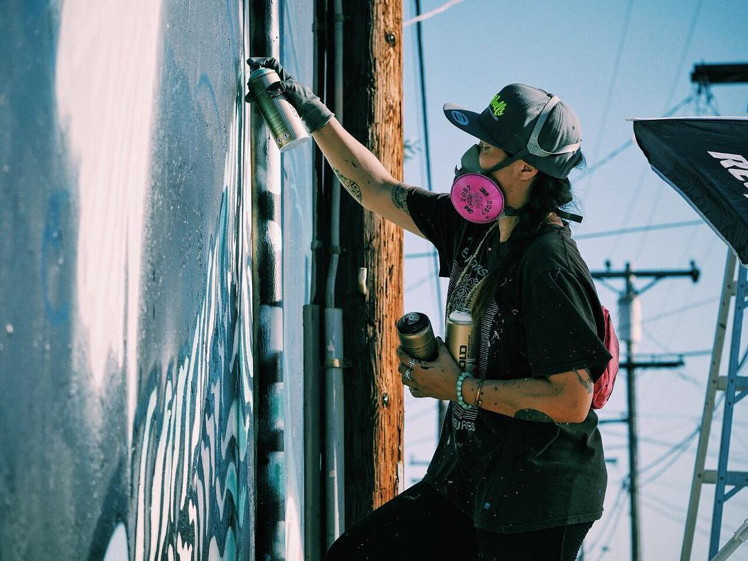 San Francisco based artist and world citizen @lolo.ys crushing it at @pangeaseed @seawalls_ murals for oceans festival in San Diego, California happening now! Follow us for more updates.  #pangeaseed #seawallsSD #paintforapurpose #spratx