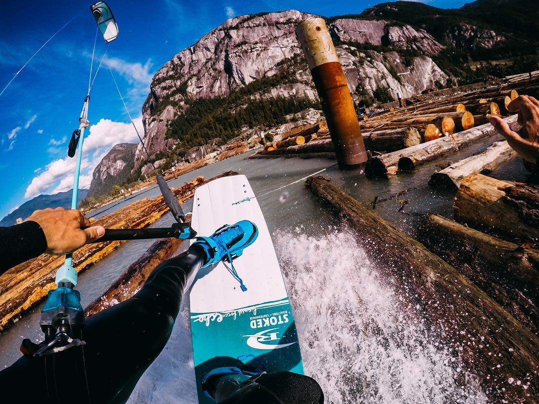 Photo of the Day! @brandonscheid taking the log line while ripping in #BC! Tight quarters for our boy! #GoPro #kiteboard #kiteboarding