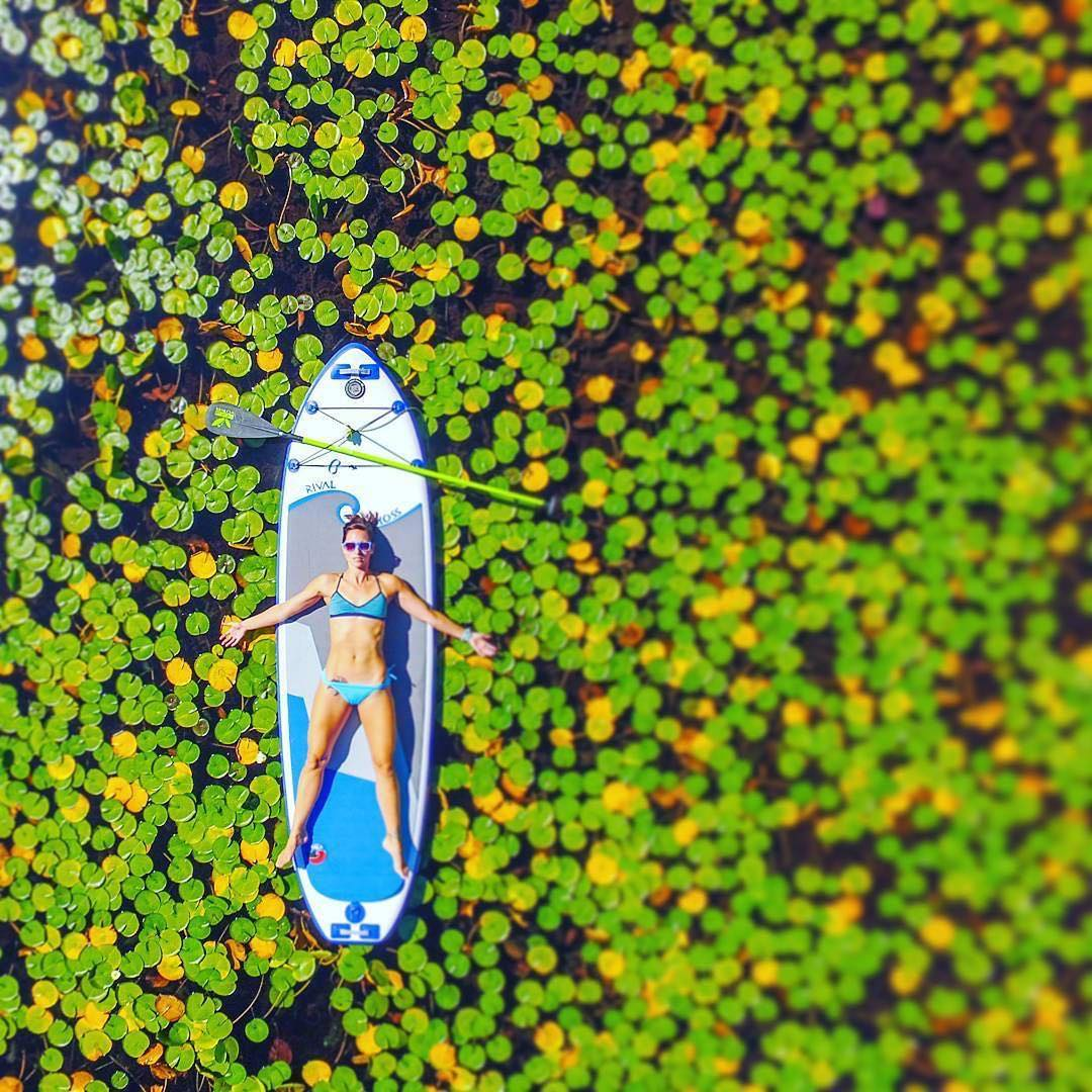 @paddlingyogini in a field of lily pads.