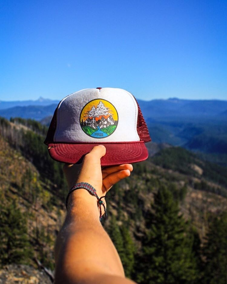 Cloud Mountain Trucked Hat from the top of a mountain. risegraphics.com #risedesigns #risedesignstahoe #truckerhat