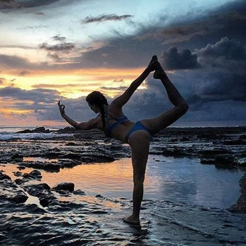 #getoutthere… there's magic everywhere! ✨ || @rima_danielle in our Thong tha Thong and Ring Back Top || photo by @thevegandj || #miolagirls #yogaeverydamnday #sunsetyoga #beachyoga