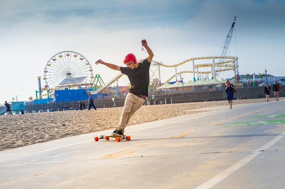 @mari_aprilfool captured this moment of #LoadedAmbassador @axel_montgomery spreading his arms on the #LoadedVanguard  #SantaMonicaPier #Orangatang #Orange #InHeats