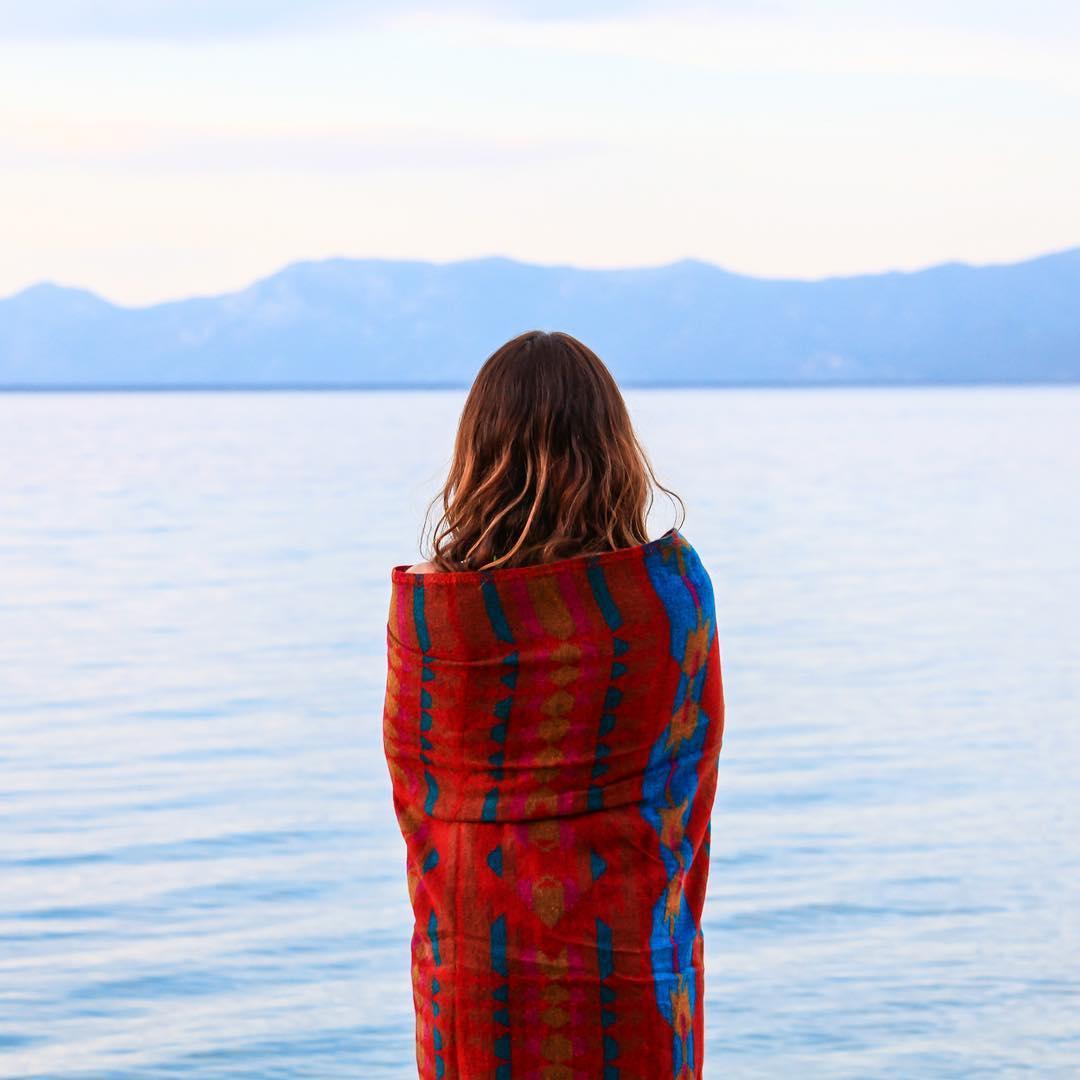 Tahoe is always there. Red Montara Blankets keeping you warm all year round.  #red #Montara #throw #glamping #laketahoe #tahoe #lakeofthesky #juliaszendrei #blue #bigblue #woolblanket #livingspace #homedecor #designer #design #homedecor