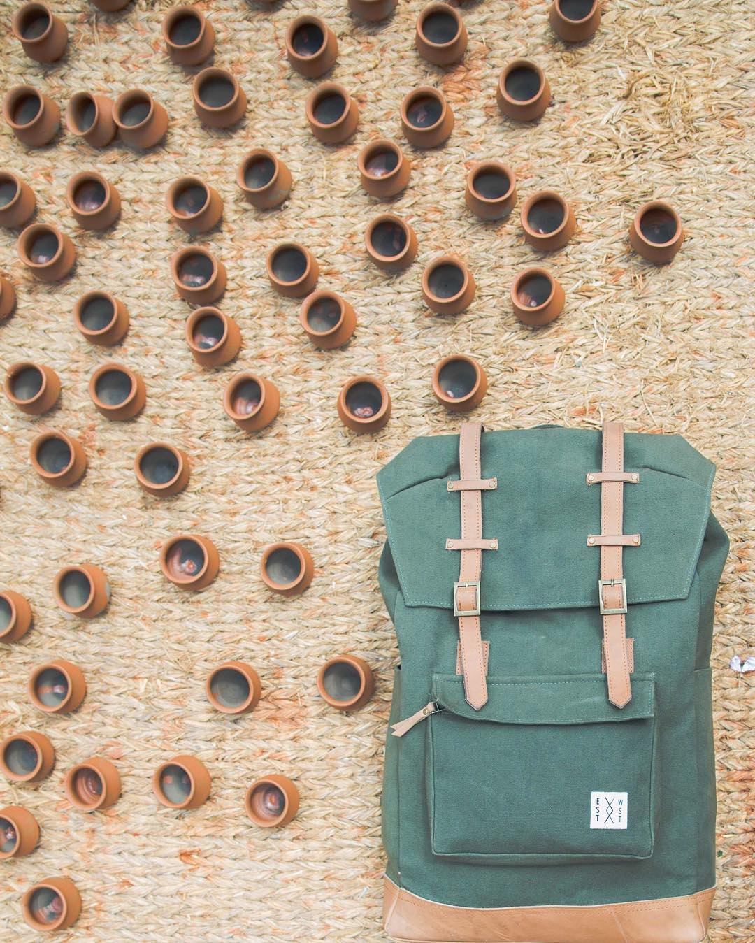 Earth tones in our classic rucksack. Featuring our organic canvas and veg tanned leather.