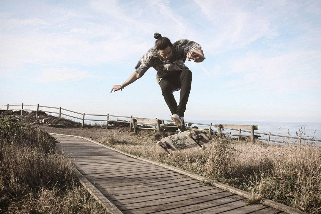 @blinlongboard with a steezy varial somewhere on the coast of Spain. photo: @paucalzon
