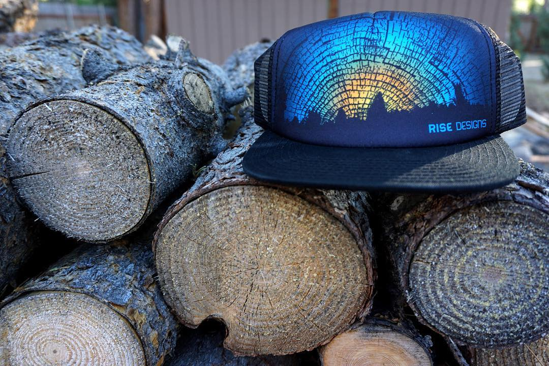 The Daybreak - inspired by nature and trees of course. #risedesigns #risedesignstahoe #inspiredbynature #drivenbydesign #truckerhat #tahoe #woodgrain www.risegraphics.com