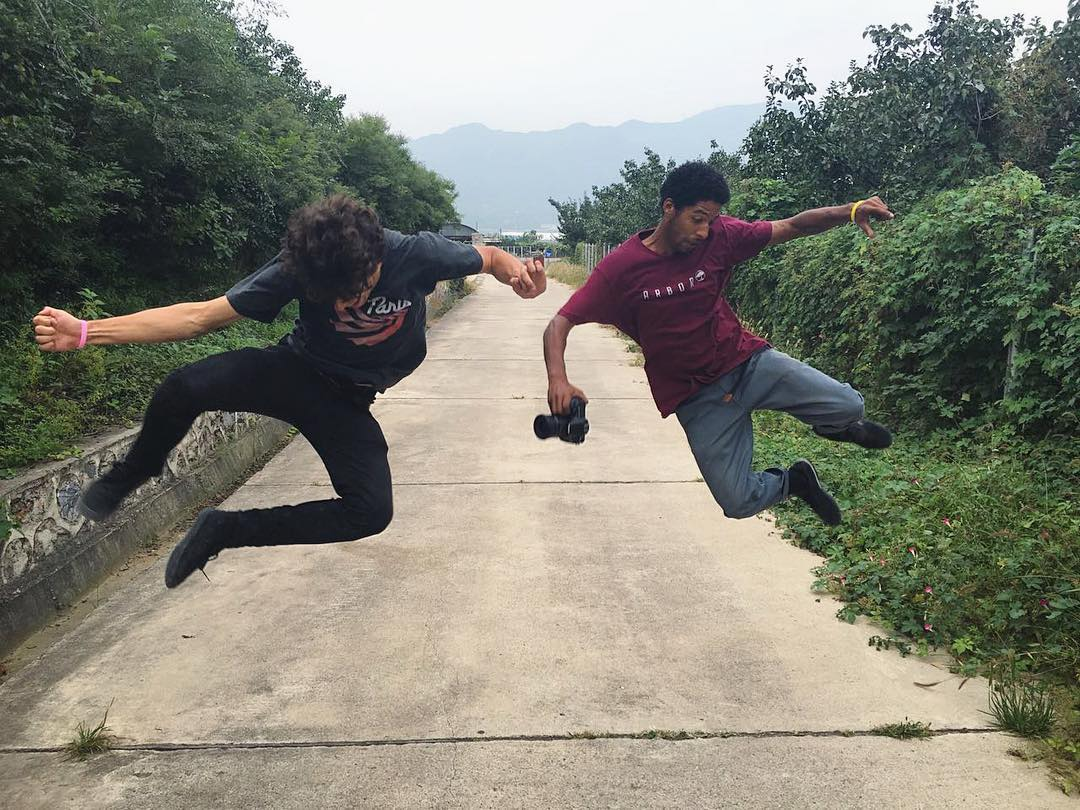 @ari_shark and @agboton had their moves dialed in China, including their Kung Fu // Matrix style heel clickers on a path through the jungle.