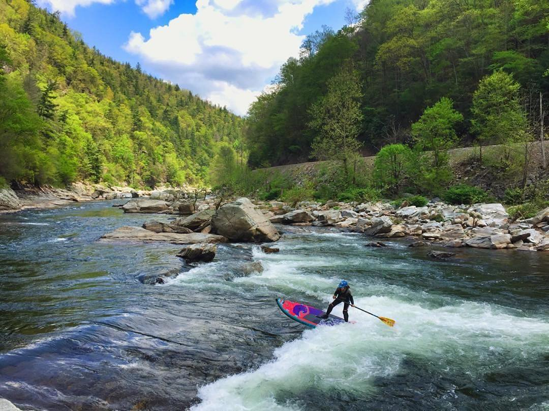 Team rider @gnardia surfing Jaws on the Nolichucky. Board: #Atcha86