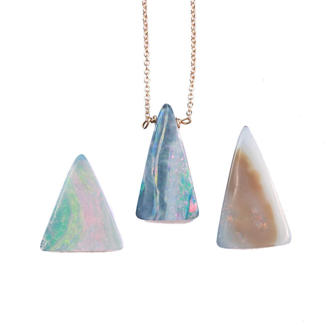 October's beautiful birthstone is Opal, which comes in a variety of  shapes, styles, colors and affiliations. Here is the newest cut gemstone: Triangle Opal Necklace They're the most beautiful pieces of mineral. #lovelyladies  #opals #boulderopals...