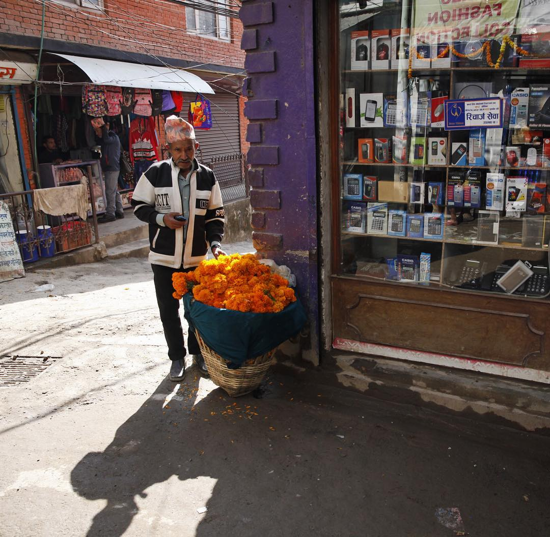 A vendor sells marigolds during a festival in Kathmandu.